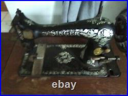 ANTIQUE SINGER SEWING MACHINE in Cabinet. With original assceories