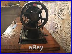 Antique 1910 Singer Sewing Machine with Treadle Cabinet