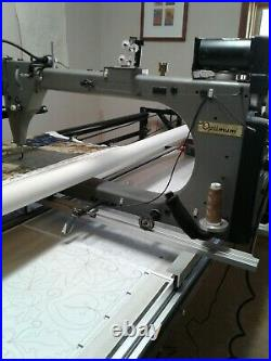 Gammill longgarm quilting machine on 14 foot table and entire quilting studio